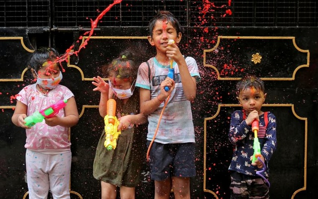 Children react as they are splashed with coloured water during Holi celebrations in Chennai, India, March 29. Reuters