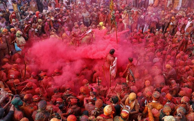 Men daubed in colours throw coloured powder at each other during Lathmar Holi celebrations in the town of Nandgaon, in the northern state of Uttar Pradesh, India, March 24. Reuters