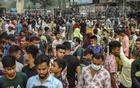 People, many of them wearing no masks, crowd a street market showing no respect for physical distancing rules in Dhaka's Gulistan on Tuesday, Mar 30, 2021 amid a record surge in coronavirus cases. Photo: Asif Mahmud Ove