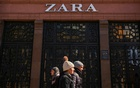 People walk past a Zara store which is closed due to a lockdown imposed to prevent the spread of the coronavirus disease (COVID-19), in central Kyiv, Ukraine March 23, 2021. REUTERS/Gleb Garanich