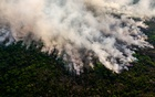 A wildfire burns through part of the vast Pantanal wetlands in Mato Grosso state, Brazil, Aug 29, 2020. Tropical forests around the world were destroyed at an increasing rate in 2020 compared with the year before, despite a global pandemic which reduced demand for some commodities that have spurred deforestation in the past. Maria Magdalena Arrellaga/The New York Times