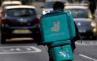 A Deliveroo delivery rider cycles in London, Britain, March 8, 2021. REUTERS