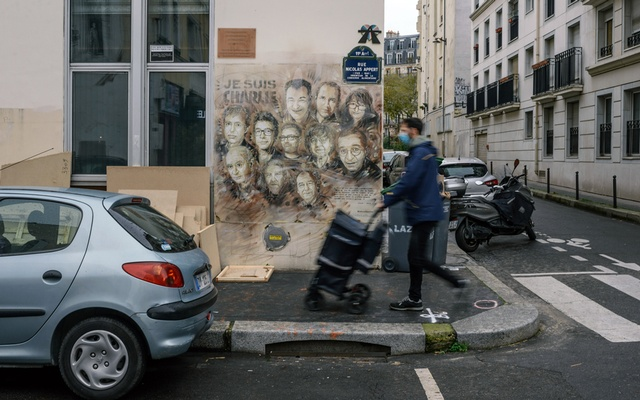 A mural pays tribute to victims of the Charlie Hebdo attack near the magazine's former offices in Paris on Dec 14, 2020. No other country in Western Europe has suffered as much from terrorism as France over the past decade. Dmitry Kostyukov/The New York Times