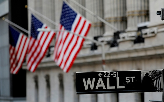 American flags hang from the facade of the New York Stock Exchange (NYSE) building after the start of Thursday's trading session in Manhattan in New York City, New York, US, January 28, 2021. REUTERS