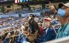 Baseball fans sit socially distanced in their assigned seats at LoanDepot Stadium in Miami on Thursday, April 1, 2021, on opening day as the Miami Marlins take on the Tampa Bay Rays. The New York Times