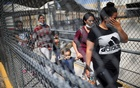 Asylum-seeking migrants from Central America who were deported from the US walk near the Lerdo Stanton international border bridge in Ciudad Juarez, Mexico Mar 30, 2021. REUTERS