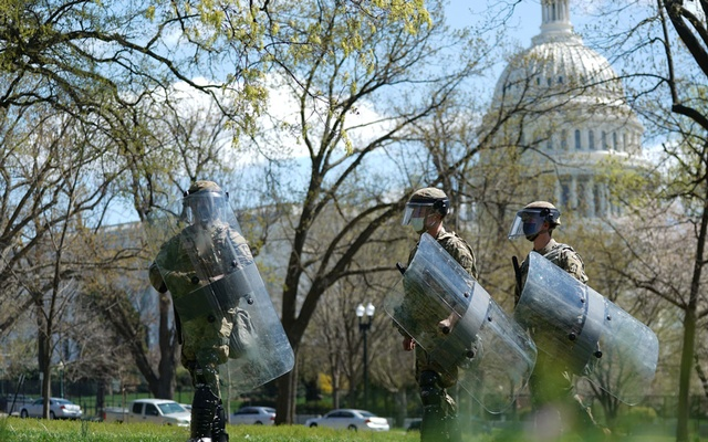US National Guard troops patrol streets surrounding the US Capitol and congressional office buildings following a security threat at the US Capitol in Washington, DC, US April 2, 2021. Reuters