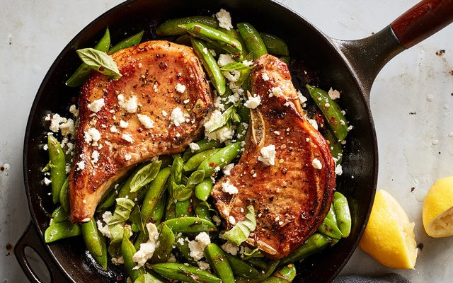 One pan pork chops with feta, snap peas, and mint, on May 21, 2019. Food styled by Rebecca Jurkevich. Johnny Miller/The New York Times