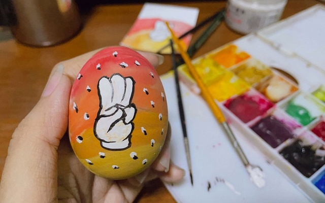 An Easter egg painted with a three-finger salute, as part of a campaign for an Easter egg protest against military rule, is seen in this picture posted on social media in Yangon, Myanmar Apr 3, 2021. REUTERS.