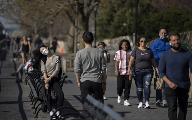 People walk along Rockefeller Park in New York on March 26th, 2021, amid the coronavirus pandemic. Hardcore business travellers have no intention of going back to the old ways and workers who cater to their needs don't have as many choices. The New York Times