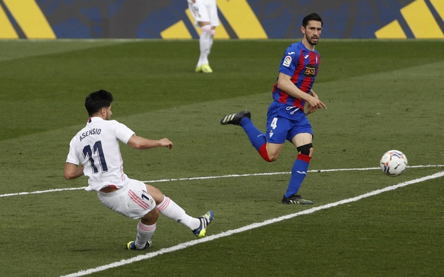 Football - La Liga Santander - Real Madrid v Eibar - Estadio Alfredo Di Stefano, Madrid, Spain - April 3, 2021 Real Madrid's Marco Asensio scores their first goal. REUTERS