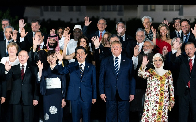 World leaders, some with their spouses, pose for a group photo at Osaka Castle following the first day of the Group of 20 summit in Osaka, Japan on Friday, June 28, 2019. The New York Times