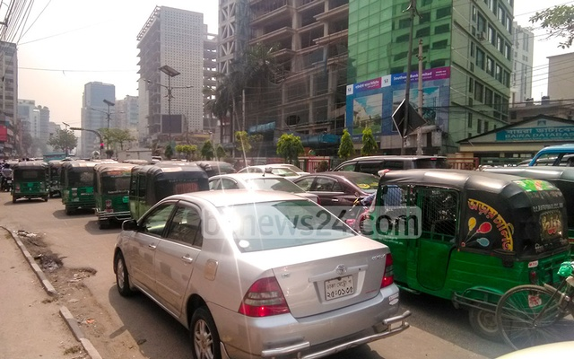 A long tailback forms in Dhaka's Shantinagar on the second day of a week-long nationwide lockdown amid a surge in coronavirus infections and deaths in the country. Photo: Sumon Mahmud