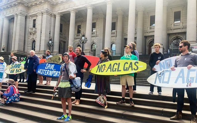 Protesters against AGL's natural gas import terminal in Western Port Bay gather in front of Parliament House on Spring Street, in Melbourne's central business district, Australia, Mar 10, 2021. REUTERS