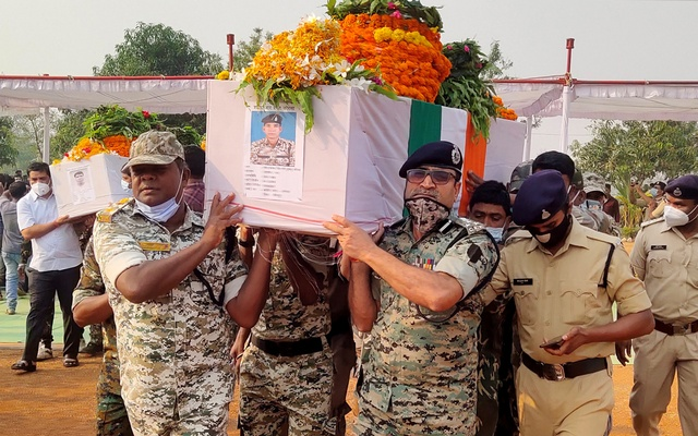 Security forces officers carry the body of a colleague, who was killed in an attack by Maoist fighters, during a wreath laying ceremony in Bijapur in the central state of Chhattisgarh, India, April 5, 2021. REUTERS