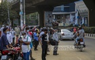 People wait for transports to return home after work at Mohakhali in Dhaka on Tuesday, Apr 6, 2021 amid a ban on bus services to contain a record surge in coronavirus cases. Photo: Mahmud Zaman Ovi
