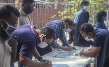 People fill out forms for coronavirus tests at Shaheed Suhrawardy Medical College Hospital in Dhaka on Wednesday, Apr 7, 2021. Photo: Asif Mahmud Ove