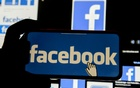 FILE PHOTO: The Facebook logo is displayed on a mobile phone in this picture illustration taken December 2, 2019. REUTERS/Johanna Geron/Illustration//File Photo