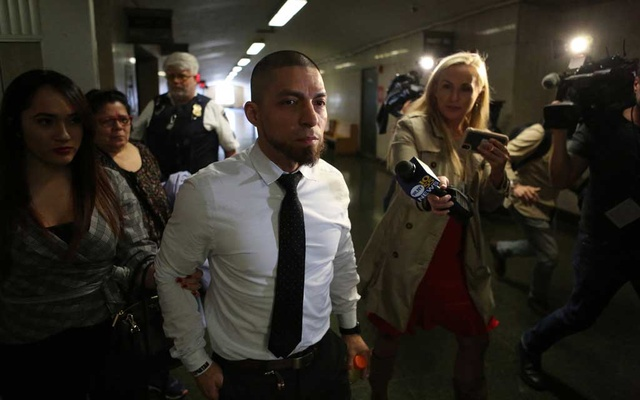 Then New York Police Department Detective Joseph Franco is escorted to his arraignment in Manhattan, April 24, 2019. The New York Times. Photo file name: us-detective-070421-01