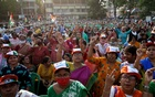 Supporters of the Chief Minister of the eastern state of West Bengal and Trinamool Congress (TMC) Chief, Mamata Banerjee, attend an election campaign rally ahead of the forth phase of the state election, amidst the spread of the coronavirus disease (COVID-19), in Kolkata, India, Apr 7, 2021. REUTERS