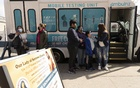 People wait for COVID-19 testing at a mobile testing vehicle, outside Our Lady off Sorrows Roman Catholic Church in Queens on Tuesday, March 23, 2021. The average number of new cases of the coronavirus in the United States has reached more than 62,000 a day as of Tuesday, April 6, 2021, concentrated mostly in Michigan and the New York City region. The New York Times