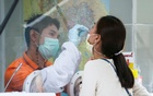 A healthcare worker takes a nasal swab sample from a local resident for a COVID-19 test after hundreds of residents of Watthana district and the trendy Thonglor neighbourhood tested positive for the coronavirus disease (COVID-19) in Bangkok, Thailand, April 8, 2021. REUTERS