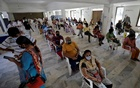 People sit in a waiting area to receive a dose of COVISHIELD, a coronavirus disease (COVID-19) vaccine manufactured by Serum Institute of India, at a vaccination centre in Ahmedabad, India, April 2, 2021. REUTERS