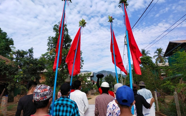 Demonstrators carry flags as they protest against the military coup in a village in Launglon township, Myanmar Apr 9, 2021. REUTERS