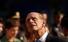 Prince Philip, Duke of Edinburgh looks up after Britain's Queen Elizabeth (not pictured) dedicated a wreath of flowers at the site of the Sept 11, 2001 World Trade Center attack during her visit to New York July 6, 2010. REUTERS