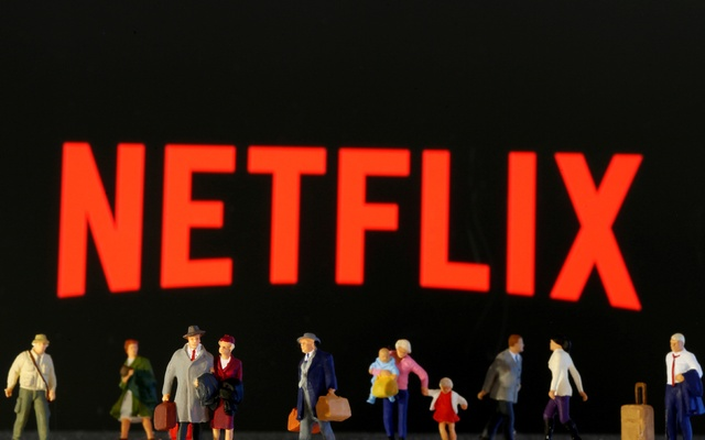Small toy figures are seen in front of diplayed Netflix logo in this illustration taken March 19, 2020. REUTERS