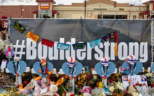 A makeshift memorial to the victims of the mass shooting at the King Soopers supermarket in Boulder, Colo., on March 30, 2021. Ten people were killed by a 21-year-old gunman whose motives remain a mystery. (Stephen Speranza/The New York Times)