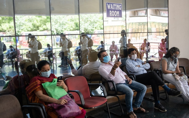 People wait in an observation area after receiving a COVID-19 vaccine at Dr Ram Manohar Lohia Hospital in New Delhi on April 9, 2021.(Rebecca Conway/The New York Times)