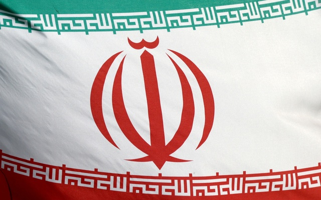FILE PHOTO: The Iranian flag waves in front of the International Atomic Energy Agency (IAEA) headquarters in Vienna, Austria, March 1, 2021. REUTERS
