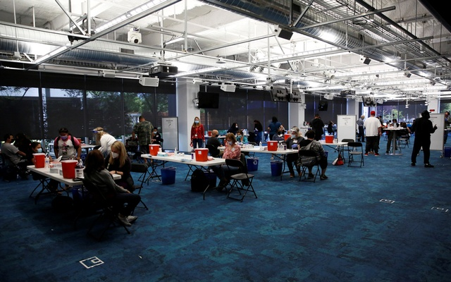 Ravenswood Family Health Centre staff and volunteers work at a newly opened coronavirus disease (COVID-19) vaccination site at Facebook headquarters in Menlo Park, California, US, April 10, 2021. REUTERS