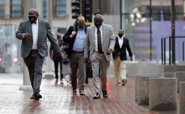 Floyd family lawyer Ben Crump and members of the Floyd family walking outside the Hennepin County Government Centre on the seventh day in the trial of former police officer Derek Chauvin, who is facing murder charges in the death of George Floyd, in Minneapolis, Minnesota, US, April 6, 2021. REUTERS