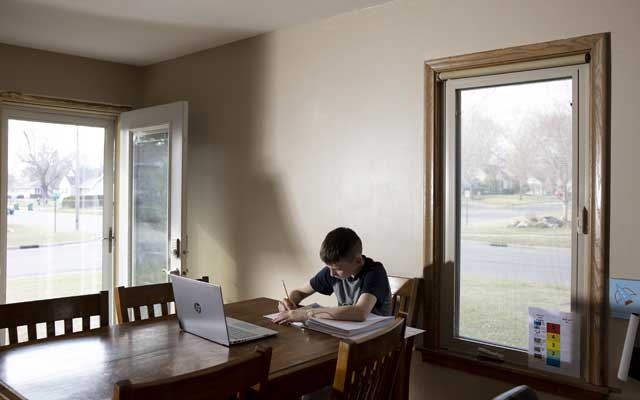 Rory Levin, 11, works at a desk at his family's home in Bloomington, Minn, April 5, 2021. Levin, a sixth grader, has been attending an online school and plans to re-enrol this fall. Virtual schools are poised to outlast the coronavirus, creating cohorts of students who may never return to traditional classrooms, though questions about remote learning persist. (Jenn Ackerman/The New York Times)