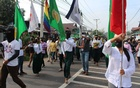 People march during a protest against the military coup in Dawei, Myanmar Apr 13, 2021. REUTERS