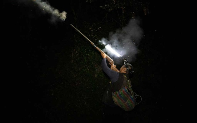 Bayan Tanapima, a Bunun hunter, fires his homemade hunting gun in the woods of Hualien, Taiwan, March 29, 2021. The New York Times