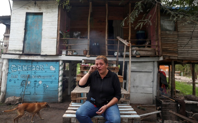 Aida Mariela Unayche, 43, gets emotional as she speaks with Reuters outside her home, in Manzanares, on the outskirts of Buenos Aires, Argentina April 8, 2021. REUTERS