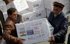 Workers from Afghan health ministry unload boxes containing vials of COVISHIELD, a coronavirus disease (COVID-19) vaccine donated by Indian government in Kabul, Afghanistan February 7, 2021. REUTERS/Omar Sobhani/File Photo