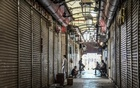 Shuttered stores in Mumbai, India, on Sunday, April 11, 2021. Cities in India are once again locking down to fight COVID-19 - and workers are once again pouring out and heading back home to rural areas, which health experts fear could accelerate the spread of the coronavirus and devastate poorly equipped villages, as it did last time. (Atul Loke/The New York Times)