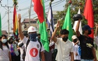 Demonstrators flash a three-finger salute during a protest against the military coup in Dawei, Myanmar April 13, 2021. Courtesy of Dawei Watch/via REUTERS