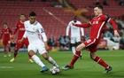 Real frustrate Liverpool to move into last four