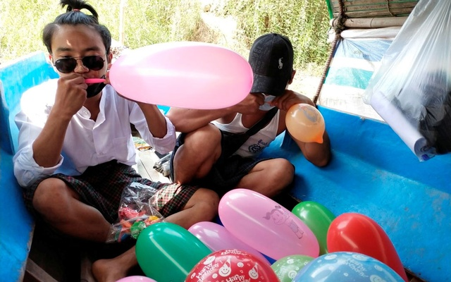 People inflate balloons to be used as form of protest against the military coup during the Thingyan festival in Hlaing River, Nyaungdon, Myanmar Apr 16, 2021. Reuters