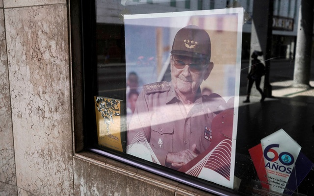 A picture of former Cuban President Raul Castro is displayed in the window of a state building in Havana, Cuba, April 11, 2021. Picture taken April 11, 2021. REUTERS/Alexandre Meneghini