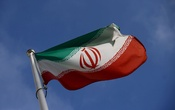 The Iranian flag waves in front of the International Atomic Energy Agency (IAEA) headquarters, before the beginning of a board of governors meeting, in Vienna, Austria, March 1, 2021. REUTERS