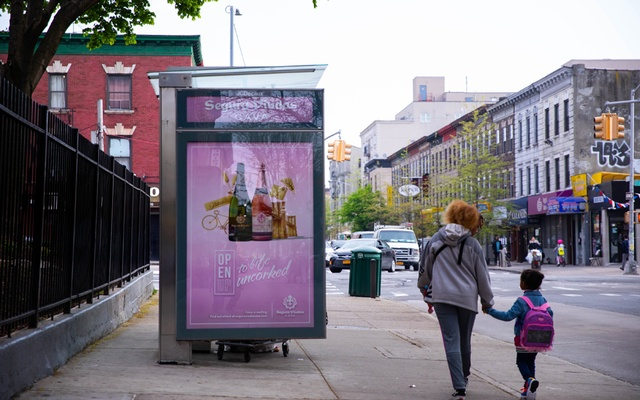 FILE -- An advertisement for sparkling wine is featured on a bus shelter in the Crown Heights section of Brooklyn on April 30, 2019, the same year New York City banned alcohol advertisements on city-owned properties such as bus shelters. Alcohol use has been up during the coronavirus pandemic, with one study showing a greater increase in misuse among women than among men. (Kevin Hagen/The New York Times)