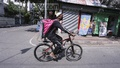 An employee of an online food delivery service rides his bicycle to pick up food from a restaurant in the Mirpur area on the seventh day of a nationwide lockdown to rein in coronavirus infections in Bangladesh, Apr 20, 2021. Photo: Asif Mahmud Ove