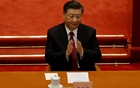 FILE PHOTO: Chinese President Xi Jinping applauds at the closing session of the Chinese People's Political Consultative Conference (CPPCC) at the Great Hall of the People in Beijing, China March 10, 2021. REUTERS