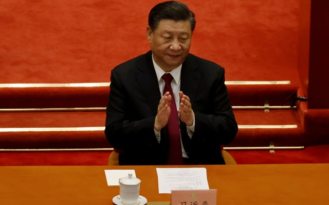 Chinese President Xi Jinping applauds at the closing session of the Chinese People's Political Consultative Conference (CPPCC) at the Great Hall of the People in Beijing, China Mar 10, 2021. REUTERS